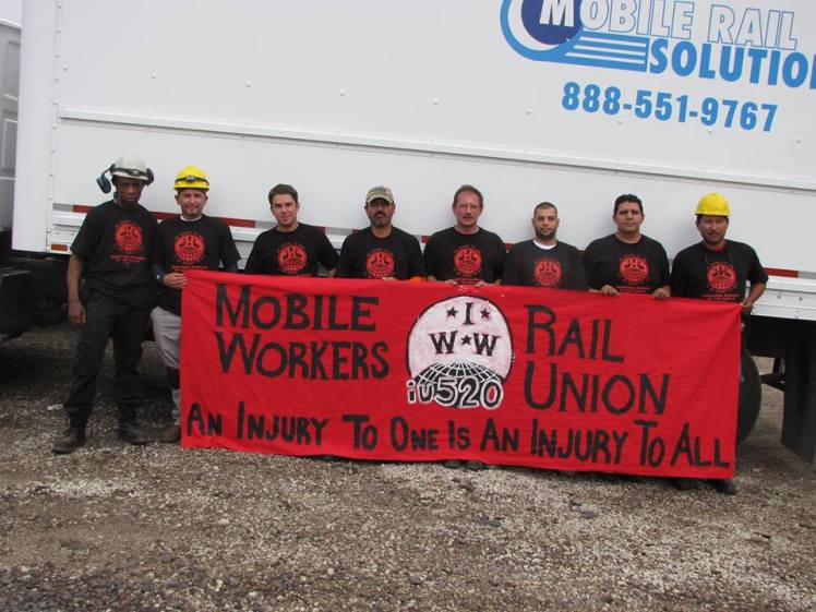 Mobile rail solutions workers with banner
