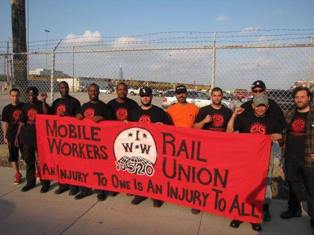 workers with banner